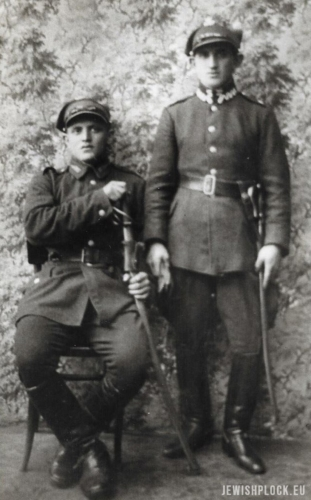 Natan Zylber (standing) and Szymon Zylber (sitting) in the Polish army wearing theiruniforms